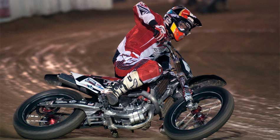 Motorcycle rider on dirt track